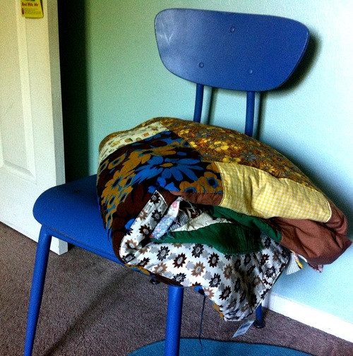 vintage school chair and vintage quilt